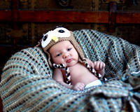 Newborn in owl hat