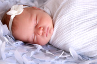 Sleeping newborn in white